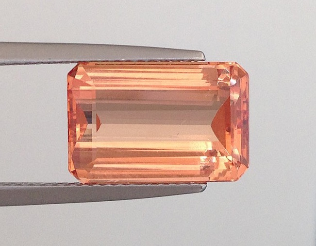 An emerald cut Imperial topaz with its perfect orangey amber color