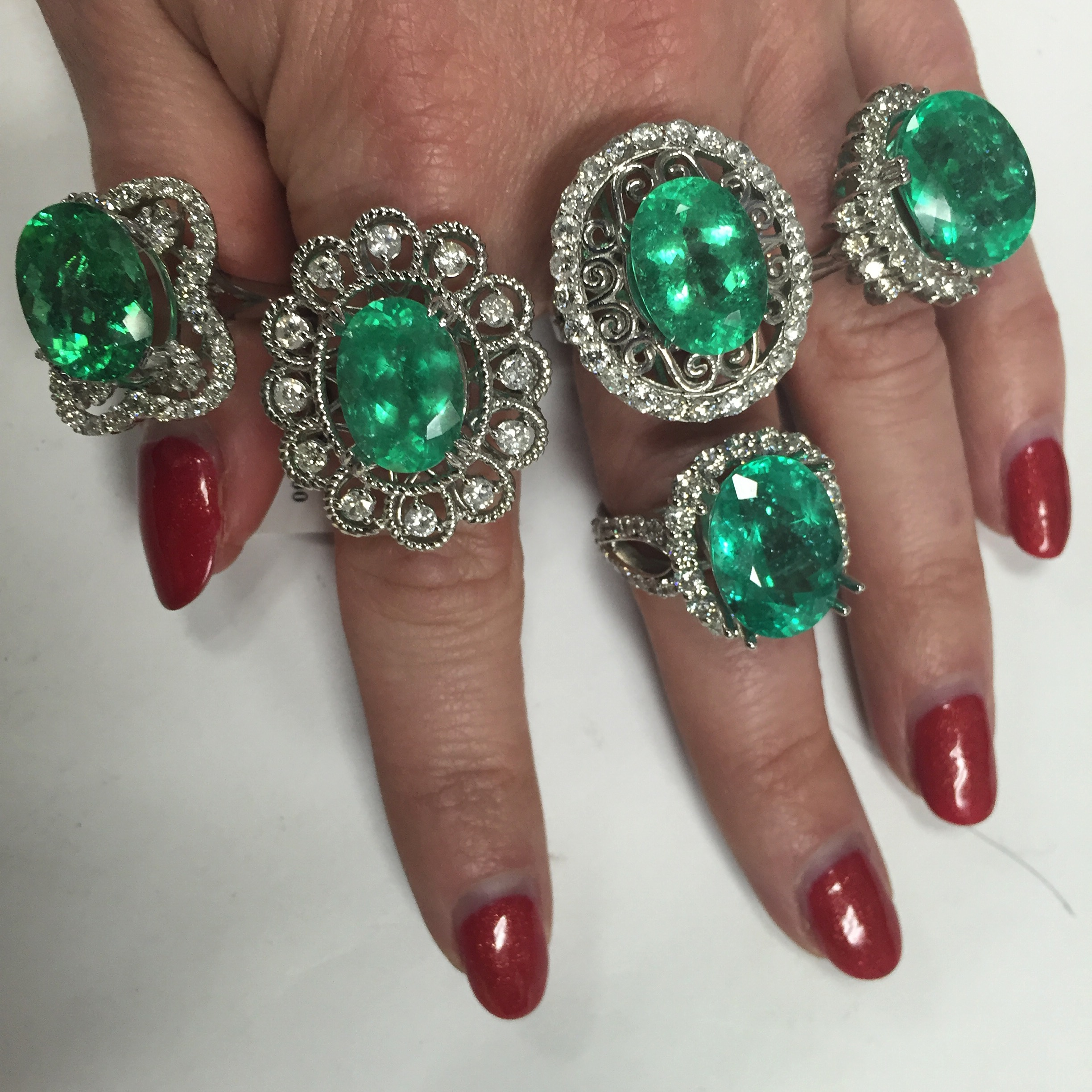 Paraiba Tourmalines elegantly stacked on her hand